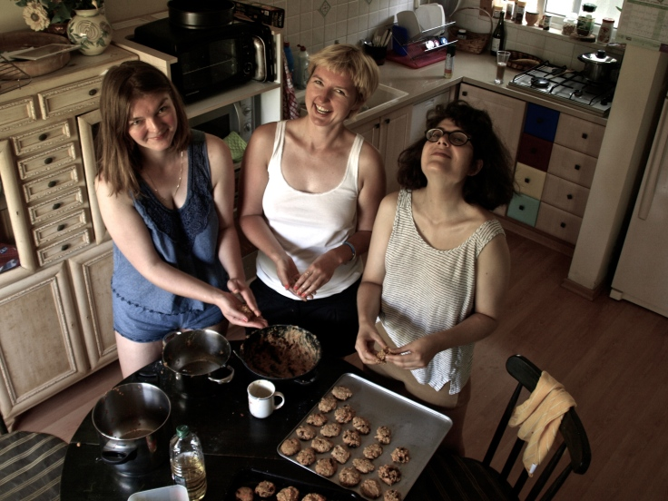 Magda, Kasia & Yaelle baking carrot cookies in Nahal Oz, Israel. Stas is taking picture.